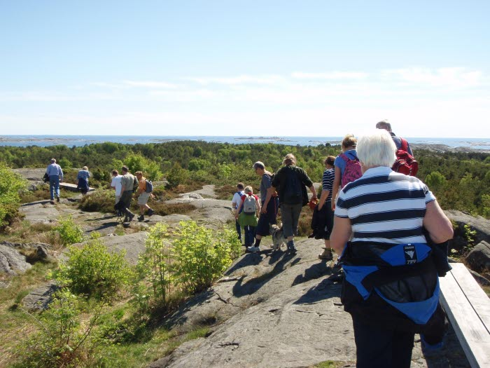 People hiking over Valfjäll, which is South Kosters highest mountain.