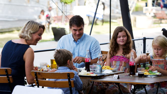Family with kids eating food