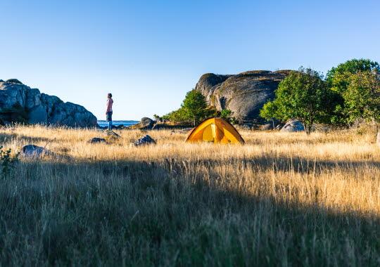Woman beside a tent in Bohuslän