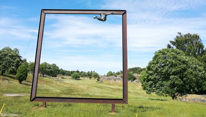 Gigantic frame in an open cultural landscape.