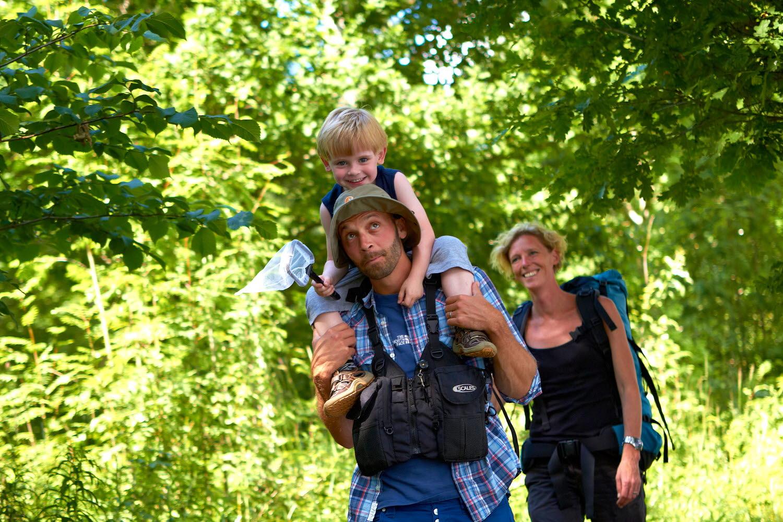 Boy riding fathers shoulders on a hike - Photo cred Jonas Ingman