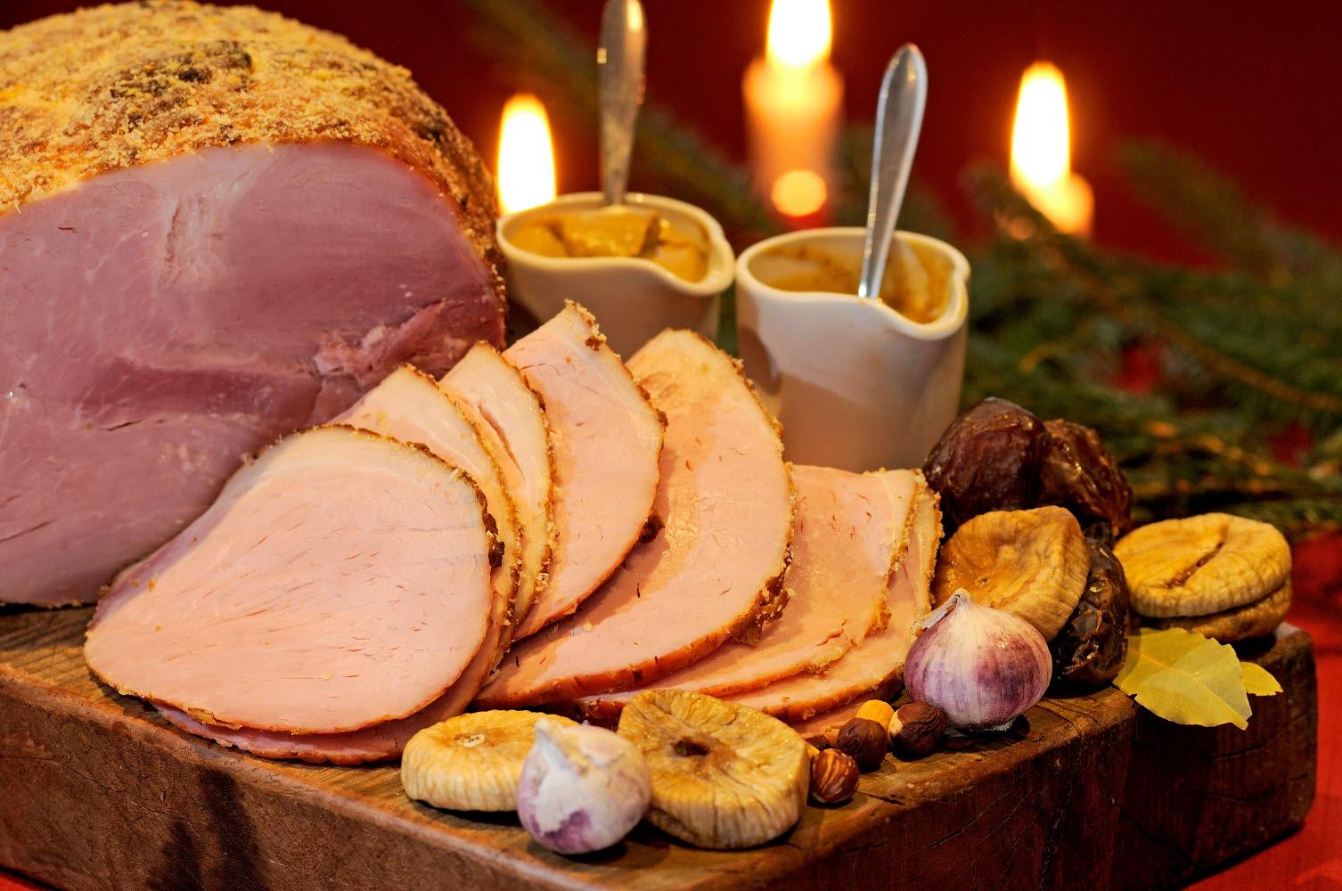 Christmas ham on a cutting board at a Christmas dinner -  Photo Cred Göran Assner