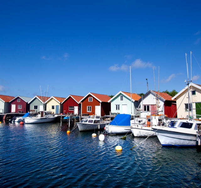 Boat houses with anchored small boats at the docks on North Koster.