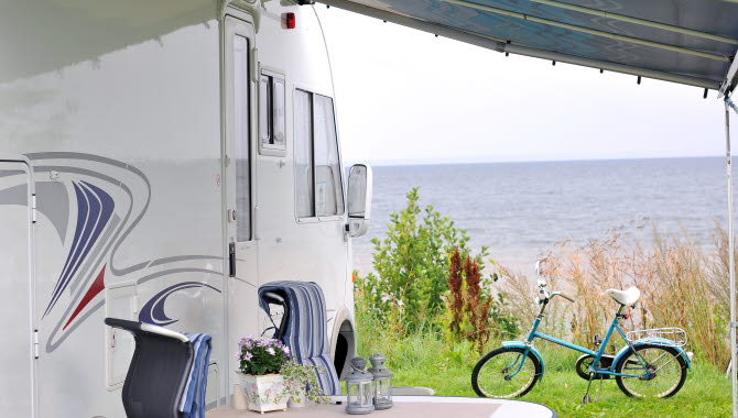 A RV at Hjo camping with a view over Lake Vättern.