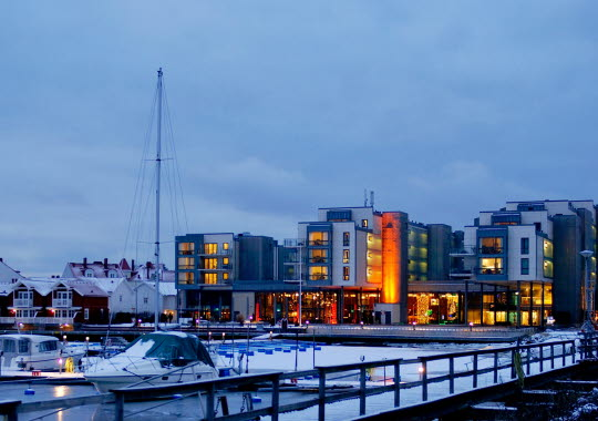 Strömstad Spa hotel in winter environment with illuminated facade.