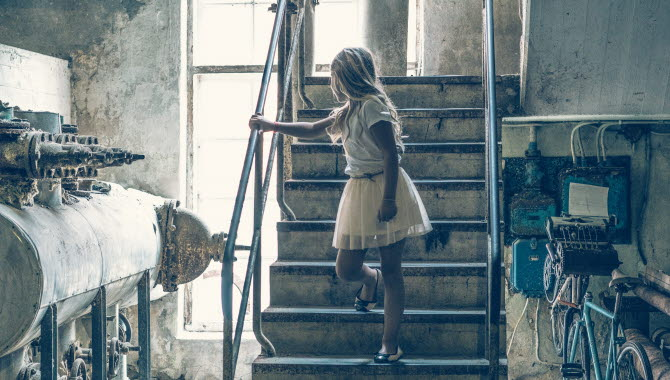 A girl stands in a stair