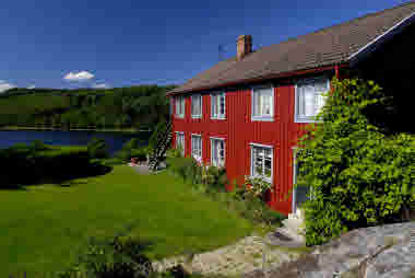Beautiful red swedish cottage by a forest lake - Photo Göran Assner.jpg