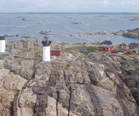 Aerial photo of the island Ursholmen with two lighthouses.