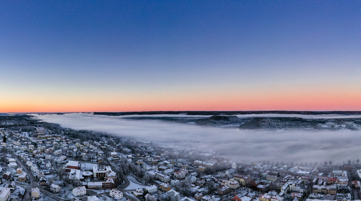 Winter view of Ulricehamn when the sun is going up.